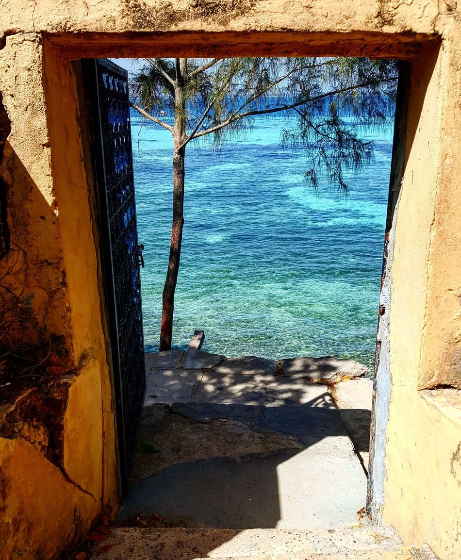Built Structure Nature Outdoors Architecture Water Tranquil Scene Beauty Illuminated Beauty In Nature Zanzibar_Tanzania Relaxation Architecture Building Exterior Coastal Feature Vibrant Color Photographer Landscape Lifestyles
