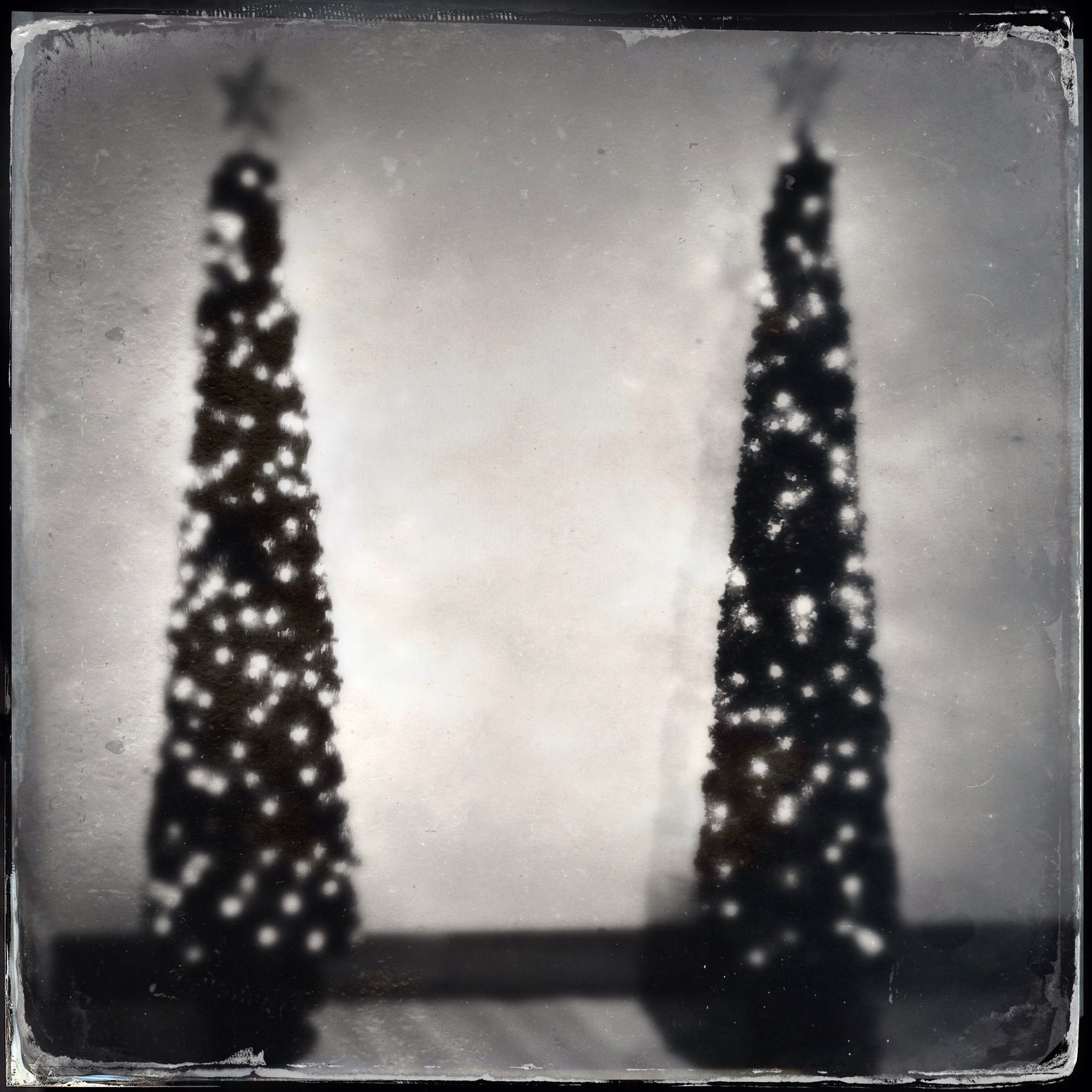 indoors, transfer print, auto post production filter, close-up, decoration, illuminated, pattern, hanging, lighting equipment, no people, design, glass - material, metal, christmas decoration, decor, christmas, black color, high angle view, still life, transparent