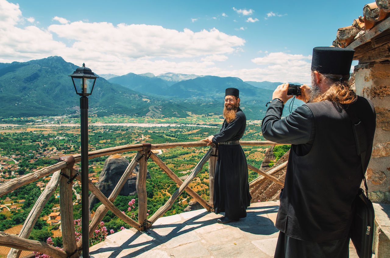 Priest takes a photo of another priest on the background of beautiful landscape in Meteora, Greece People And Places Camera - Photographic Equipment Feel The Journey My CommuteFunny Moments Greece Landscape Leisure Activity Lifestyles Meteora Monastery Mountain Observation Point Outdoors Photographer Photoshoot Human Meets Technology Priest The Great Outdoors - 2016 EyeEm Awards Telling Stories Differently Tourism Travel Destinations Up Close Street Photography My Year My View Envision The Future