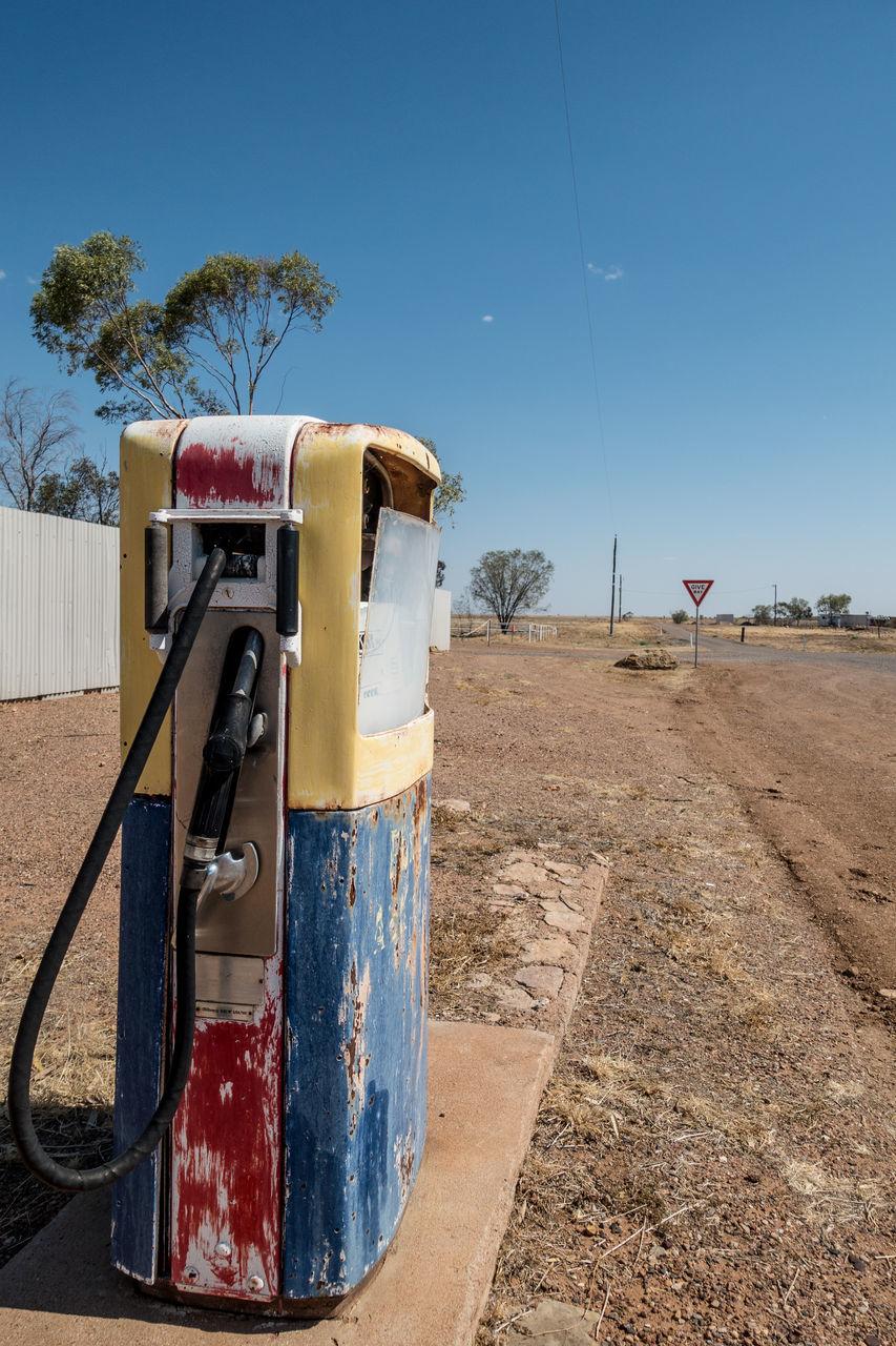 Abandoned Petrol Pump On Field Against Sky