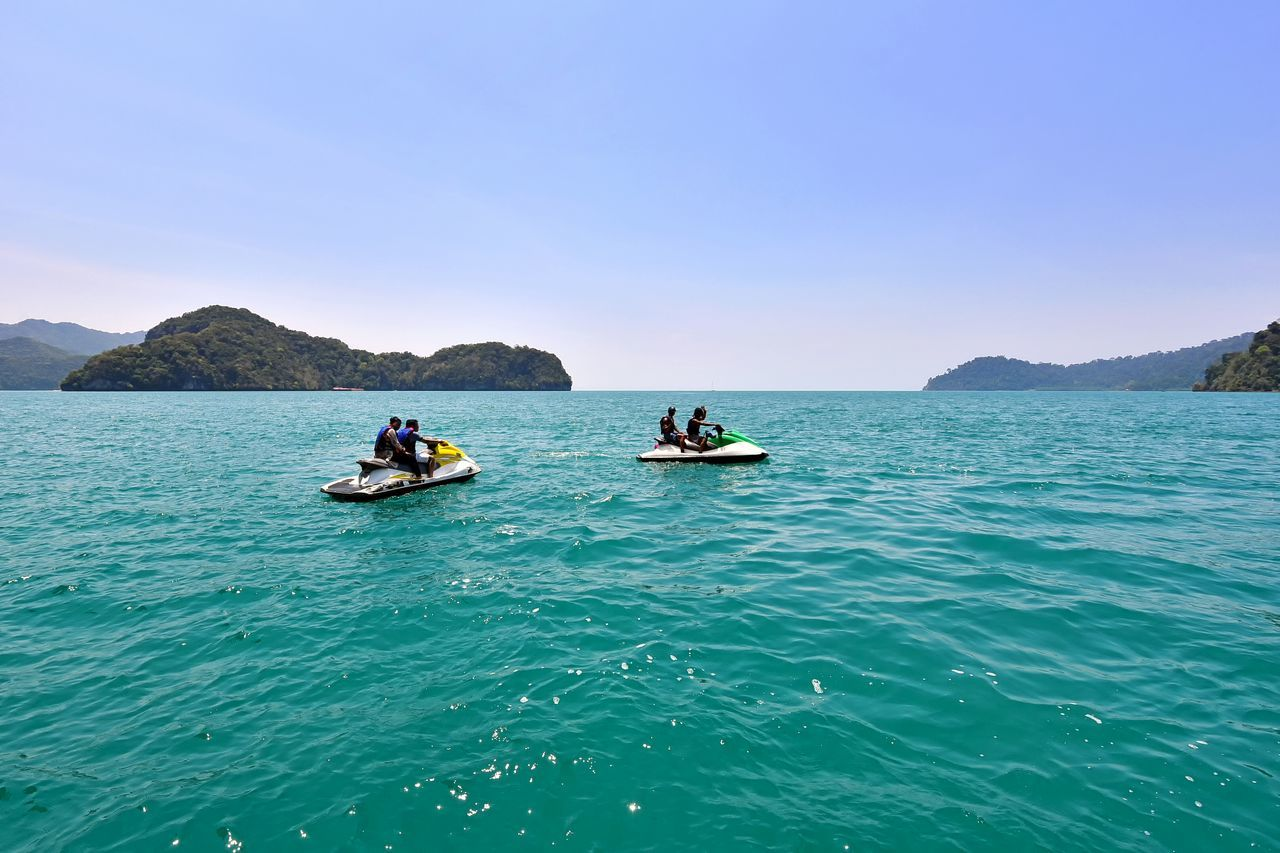 Riding jet ski in Langkawi Island, Malaysia The Great Outdoors - 2017 EyeEm Awards Jet Ski Sea Transport Leisure Activity Nautical Vessel Outdoors People Mature Adult Men Adventure Clear Sky Water Sea Beach Business Travel Destinations Eyeemphotography EyeEmbestshots EyeEmBestPics EyeEm Masterclass Getty Images Holiday Travel Langkawi Island