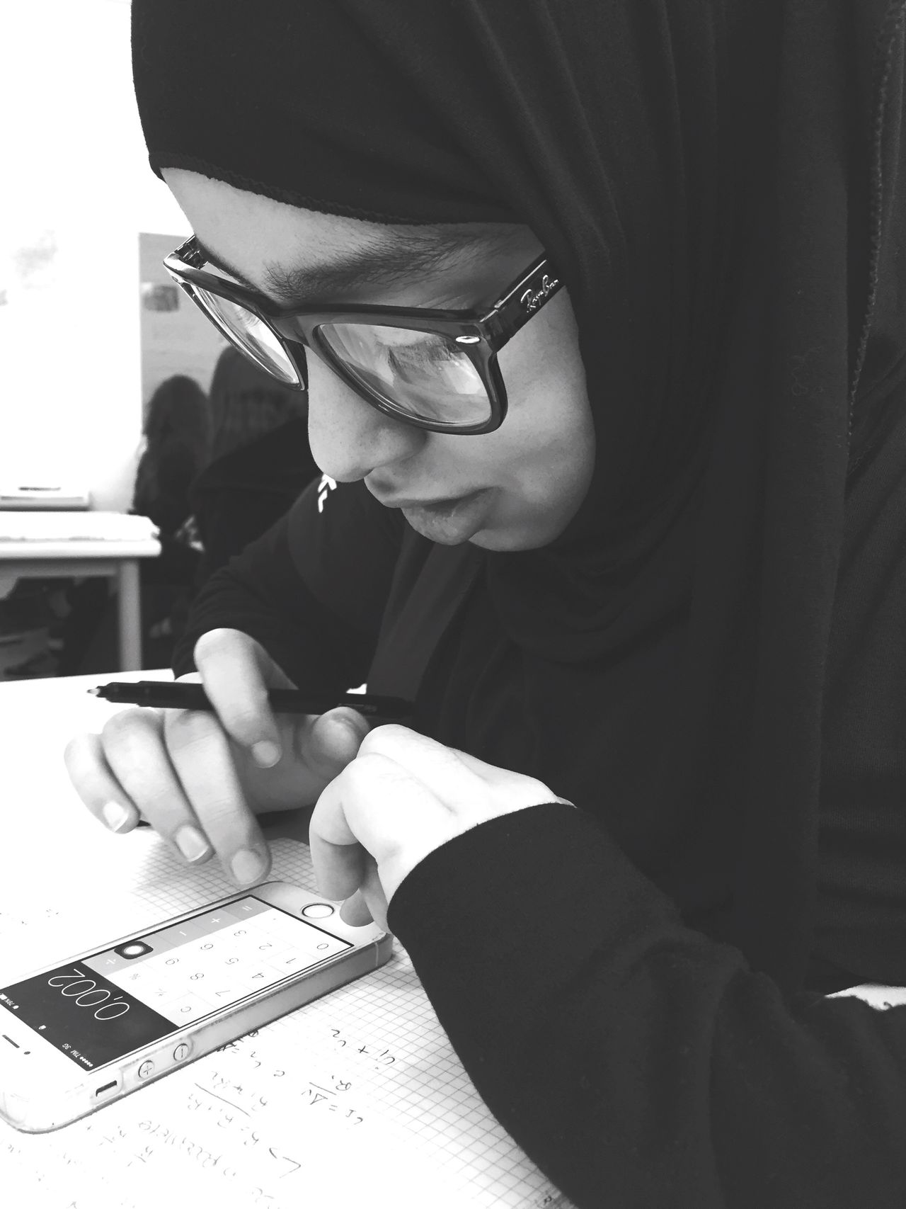 Studying Hard Real People One Person Table Indoors  Lifestyles Paper Writing Young Adult Eyeglasses  Glasses Day Close-up Human Hand Mobile Conversations