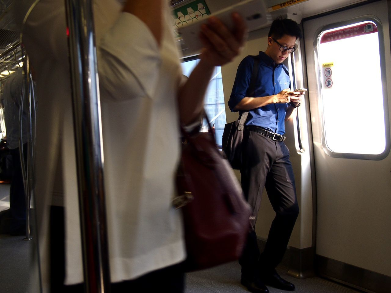 commuter in a train using his smartphone Adult Cellphone Commute Commuter Commuter Train Internet Male Online  Passenger Passenger Train People Person Smartphone Streetphotography Surf Technology The Street Photographer - 2017 EyeEm Awards Touchscreen Transportation Web