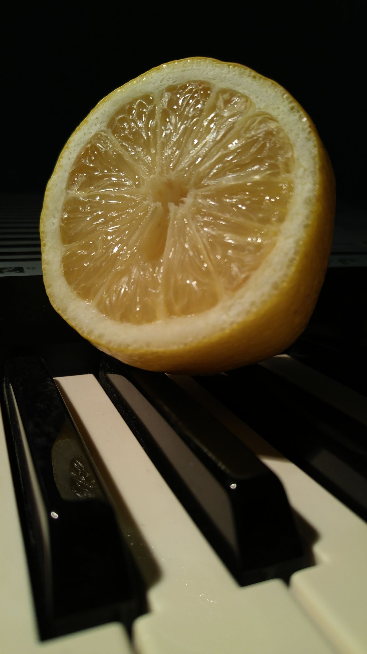 On a sour note. Sliced lemon higjlighted on piano keys. Fruit Citrus Fruit Lemon SLICE Freshness Healthy Eating Indoors  Food Close-up Black Background Sour Taste No People Food And Drink Yellow Piano Keys Yellow Blackandwhite Sliced Lemon Rind Juicy Citrus Fruit