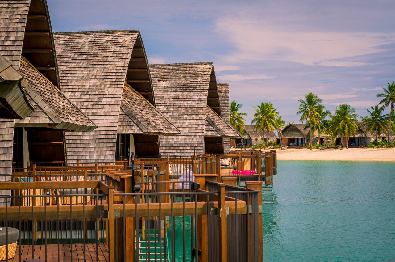 Lined up Architecture Building Exterior Built Structure Bure Day Fiji Nature No People Outdoors Palm Tree Sea Sky Tranquil Scene Tranquility Travel Destinations Water Wood - Material