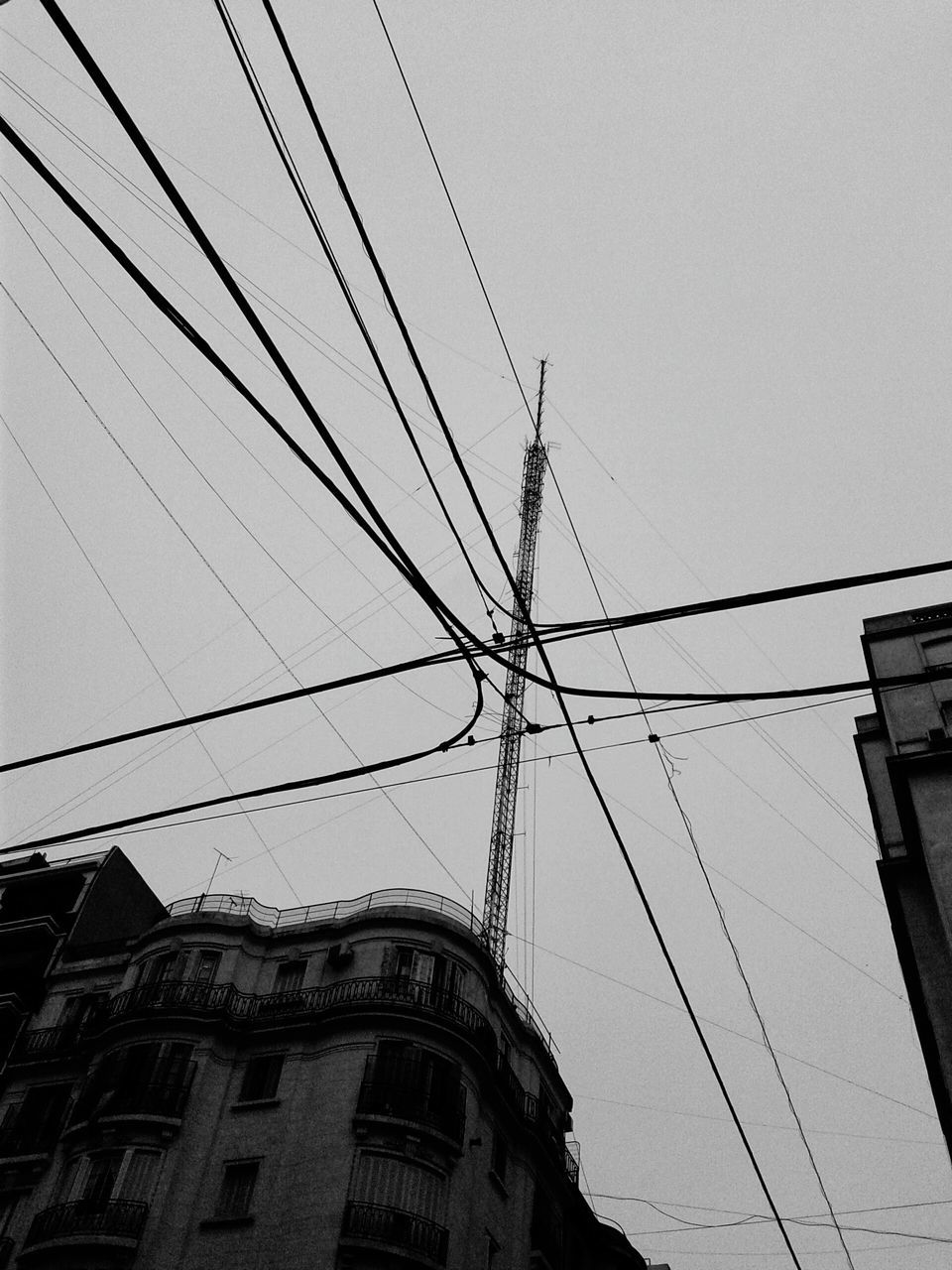 cable, low angle view, building exterior, connection, built structure, architecture, no people, power line, outdoors, day, electricity, clear sky, sky, technology