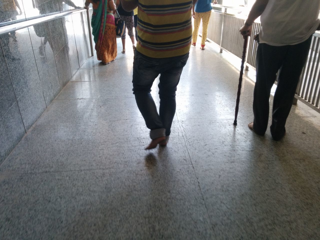 walking, low section, indoors, real people, men, togetherness, leisure activity, women, standing, lifestyles, day, people, adult