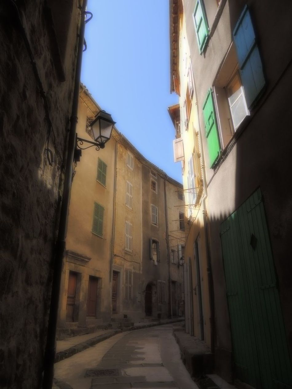 Alley Architecture Blue Building Exterior Built Structure City City Life Clear Sky Day Diminishing Perspective Long Narrow Old Town Outdoors Provence Sky Soft Light Street Surface Level The Way Forward Window