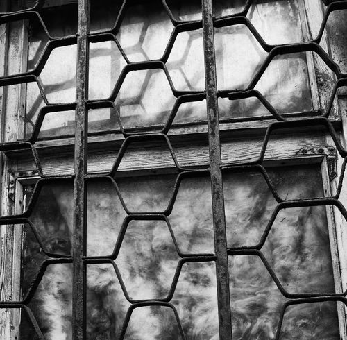 Window Chainlink Fence Metal Full Frame Outdoors No People Old Window Rust B/W Photography B/w Collection Architecture Cloud Day Refliction Wood - Material Wooden Texture Lattice Window Light And Shadows White Light Melancholy Day City Street