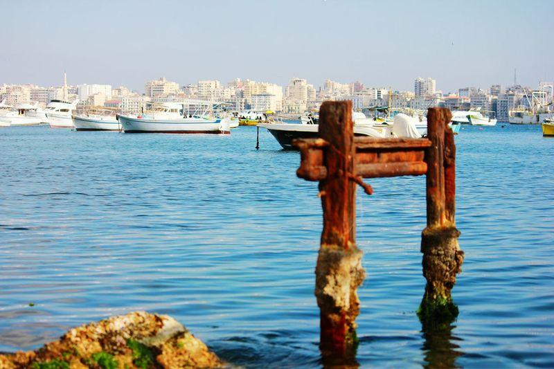 Remains of abridge Sea No People Urban Skyline City Clear Sky Harbor Outdoors Sailing Ship