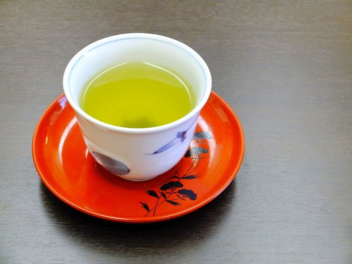 Green tea from Japan in a cup, decorative plate. Close-up Cup Day Drink Food And Drink Freshness Green Color Green Tea Healthy Eating High Angle View Indoors  Japan Japan Photography Japanese  Japanese Food Japanese Style Japanese Tea Cup No People Ocha Refreshment Saucer Table Tea Tea - Hot Drink Tea Cup