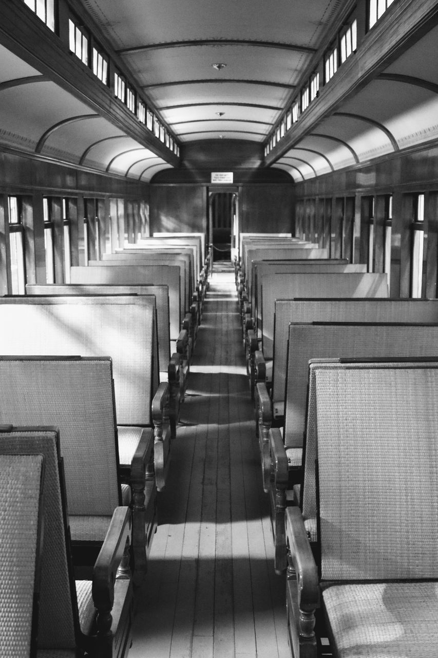 in a row, indoors, the way forward, no people, train - vehicle, vehicle seat, transportation, day