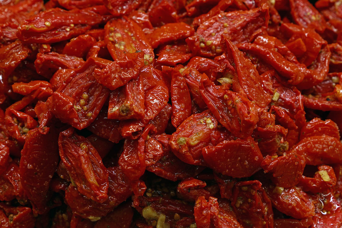 Sundried sured tomatoes on retail market stall Backgrounds Close-up Cuisine Cured Food Freshness Full Frame Healthy Eating Italian Market Ready-to-eat Red Regional Retail  Retail Display Sale Season  Seasoned Spice Stall Sun Dried Sundried Sundried Tomato Sundriedtomatoes Tomatoes