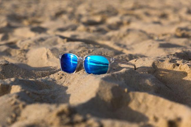 Sunglasses on the beach Sand Boscombe Pier  reflection
