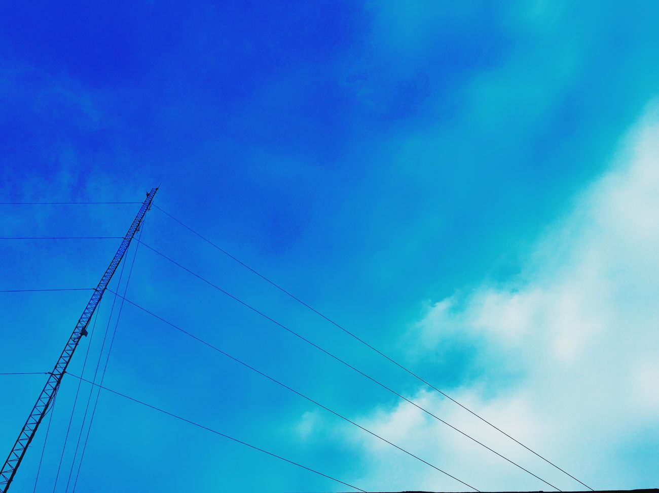 Sky Blue Connection Electricity  Cable Power Supply Power Line  No People Low Angle View Cloud - Sky Electricity Pylon Technology Outdoors Day Tranquility Nature Electricity Tower Telephone Line