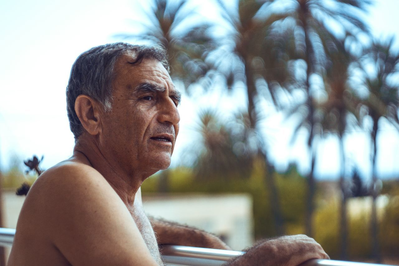 Mature Adult Adults Only Contemplation Senior Adult Headshot One Man Only One Person Only Men One Mature Man Only Sitting Outdoors Mature Men Day Dreaming Day Portrait Adult Retirement Men Showcase: January EyeEm Masterclass Eye4photography  VSCO Gray Hair Uniqueness Palm Trees