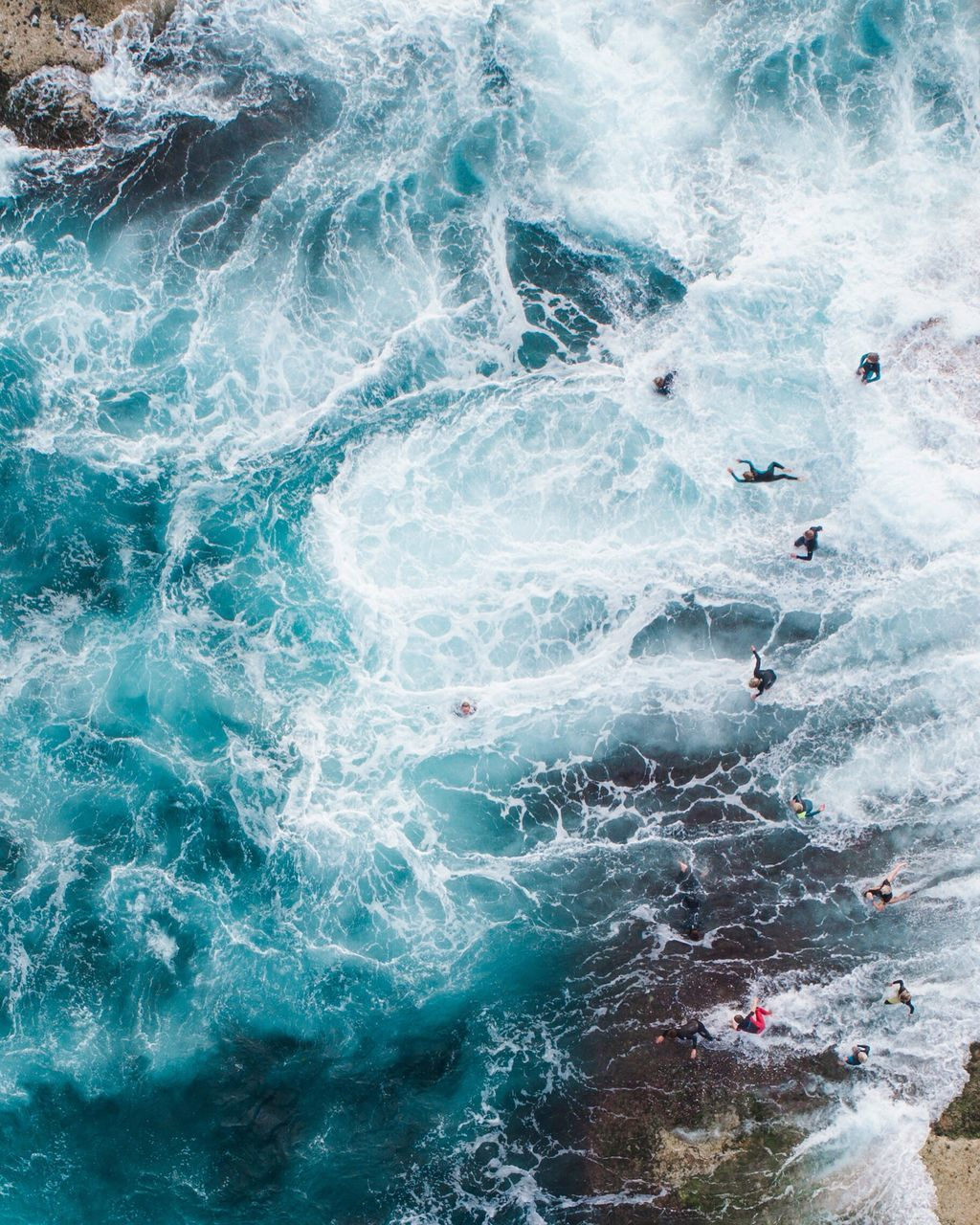 High Angle View Of Surfers In Sea