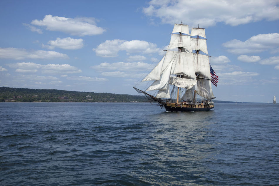 Tall ships on Lake Superior in Duluth, Minnesota American Flag Blue Brigantine Cannons Canvas Clouds And Sky Duluth Lake Mast Minnesota Ocean Old Rigging Sailing Ship Sails Ship Sunlight Tall Ship Vessel Vintage Water Waves White