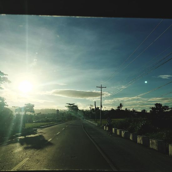 Road Transportation The Way Forward Sky Sun Cable No People Nature Sunlight Electricity Pylon Tree Scenics Outdoors Sunset Day Landscape Beauty In Nature