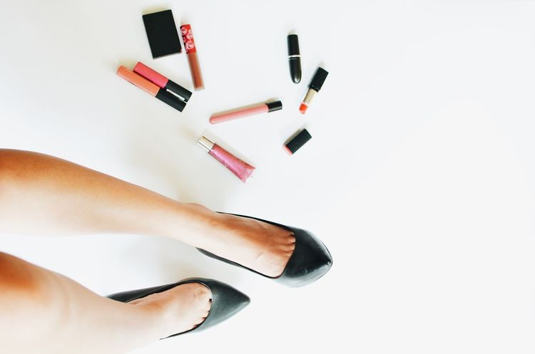 top view woman legs wearing black shoes with cosmetics set on white background. #beauty #cosmetics #fashion #LadyOFTF #lipstick #woman Adult Close-up Day Directly Above Human Body Part Human Hand Indoors  Nail Polish One Person People Real People White Background Women
