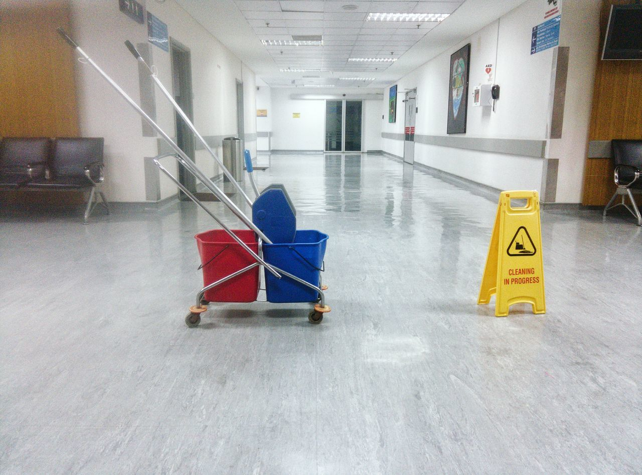 Indoors  Illuminated No People Architecture Day Cleaning Progress Cleaner Mops Floor Services Red Yellow Blue Trolley Sign Carefully Wet Floor