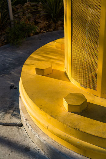 Extra large yellow lug nuts and metal housing protect pipes and other infrastructure materials outside Construction Machine XL Close-up Day Extra Large Extra Large Lug Nuts Lug Nut Lug Nuts Lugn Metal Protection No People Outdoors Street Streetphotography Tools Yellow Yellow Color