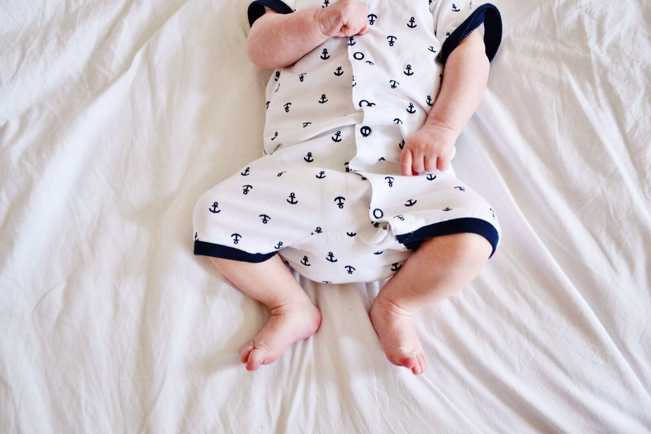 High Angle View Of Baby Lying Down On Bed