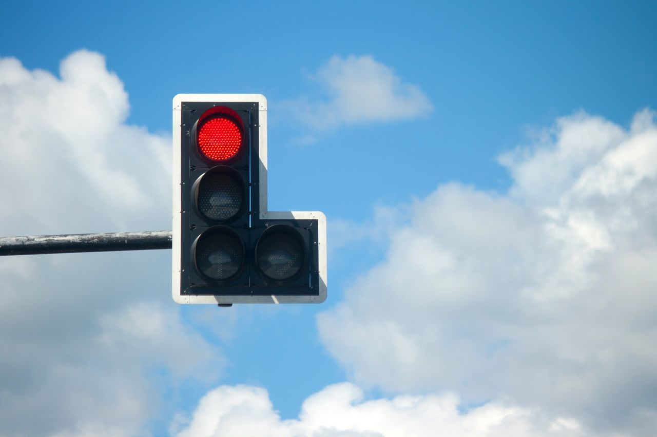 Sky Low Angle View Cloud - Sky Blue No People Outdoors Day Red Light Stoplight Nature Road Sign Traffic Signal Red Traffic Traffic Lights Traffic Jam Trafficlight Concept Conceptual Light Lighting Equipment Traffic Sign Traffic Light  Symbol