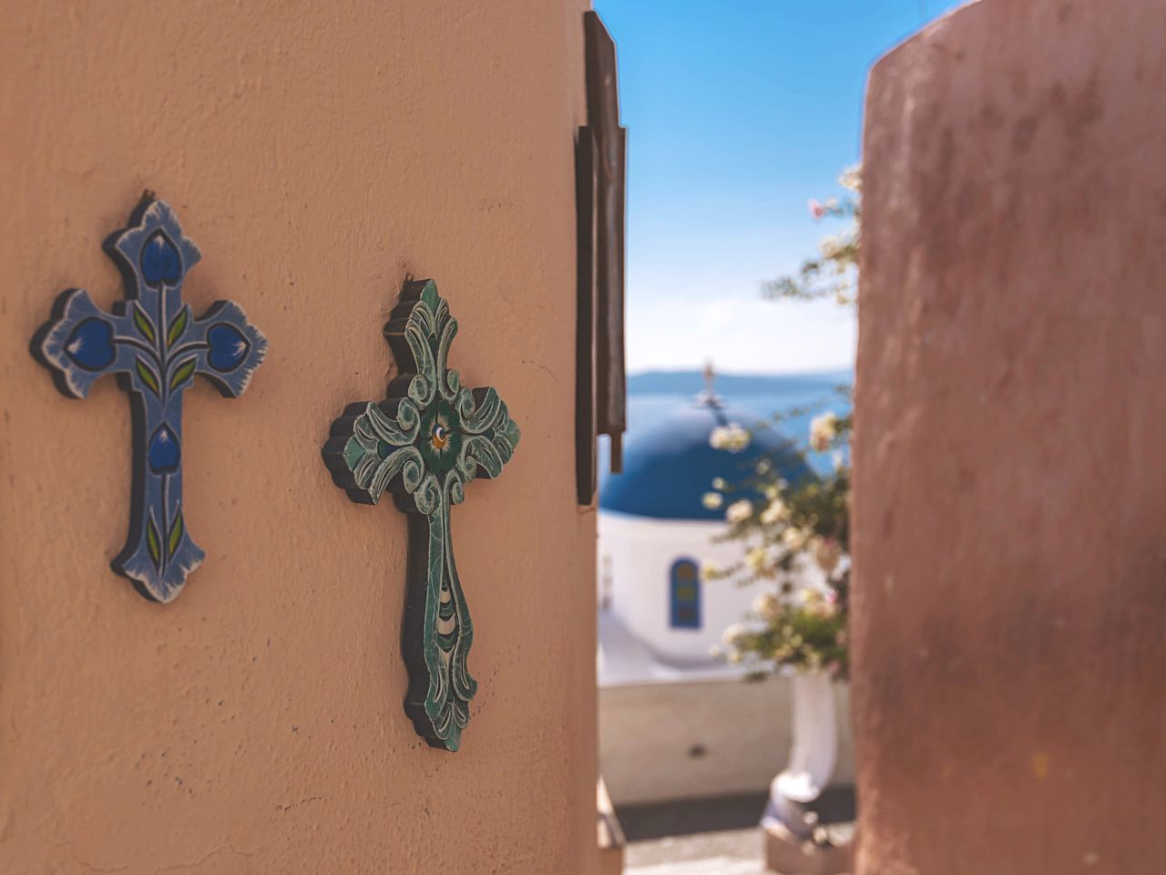 Crosses On Brown Wall At Oia