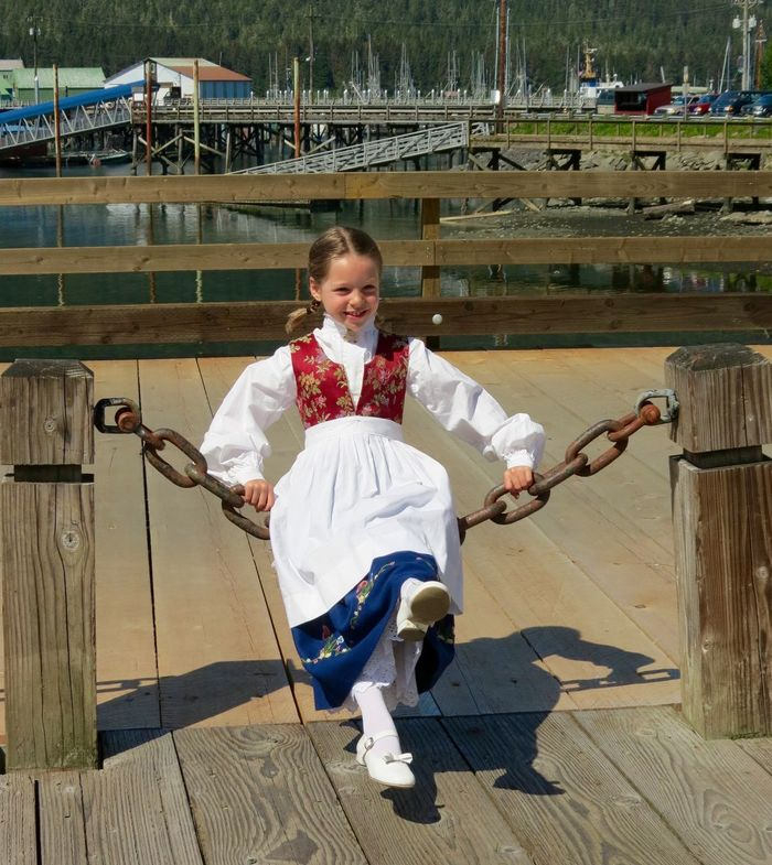 syttende mai Bunad Childhood Elementary Age Front View Girl Harbor View Lifestyles Looking At Camera Norwegian Portrait Smiling Syttendemai Traditional Costume