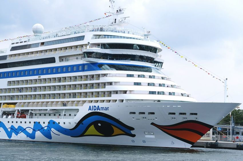 Aida Mar cruises in Warnemuende during Hansesail event. Cruising ship. Aida Aidacruises Aidamar City Cruise Ship Day HanseSail Hansesail 2016 Harbor Harbor View Low Angle View Outdoors Rostock Rostock 2016 Rostocker Hafen Rostocker Stadthafen Sailing Sailing Boat Sailing Boats Sailing Ship Sky Warnemünde