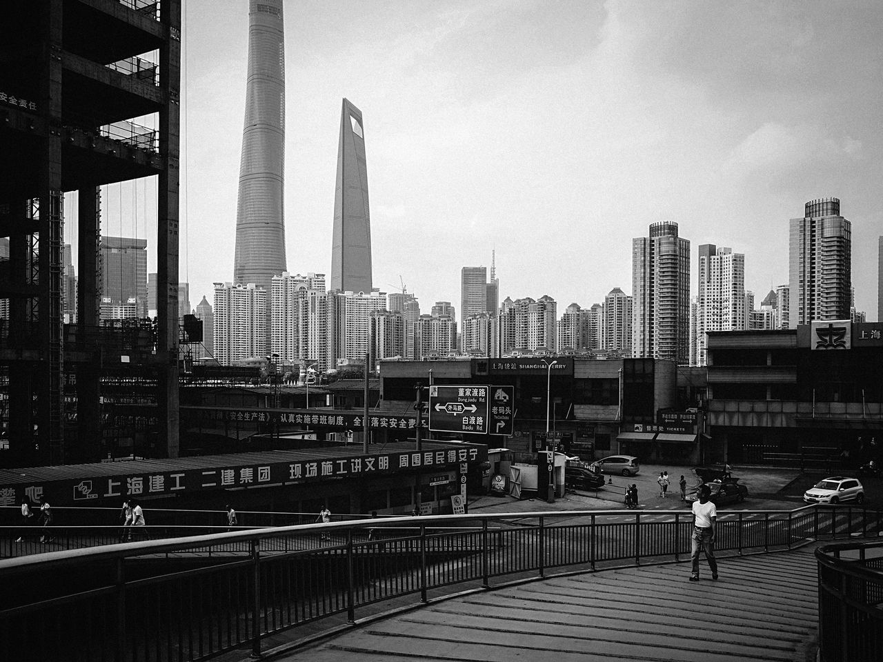 architecture, built structure, city, skyscraper, building exterior, sky, modern, transportation, bridge - man made structure, day, city life, cityscape, urban skyline, outdoors, travel destinations, real people