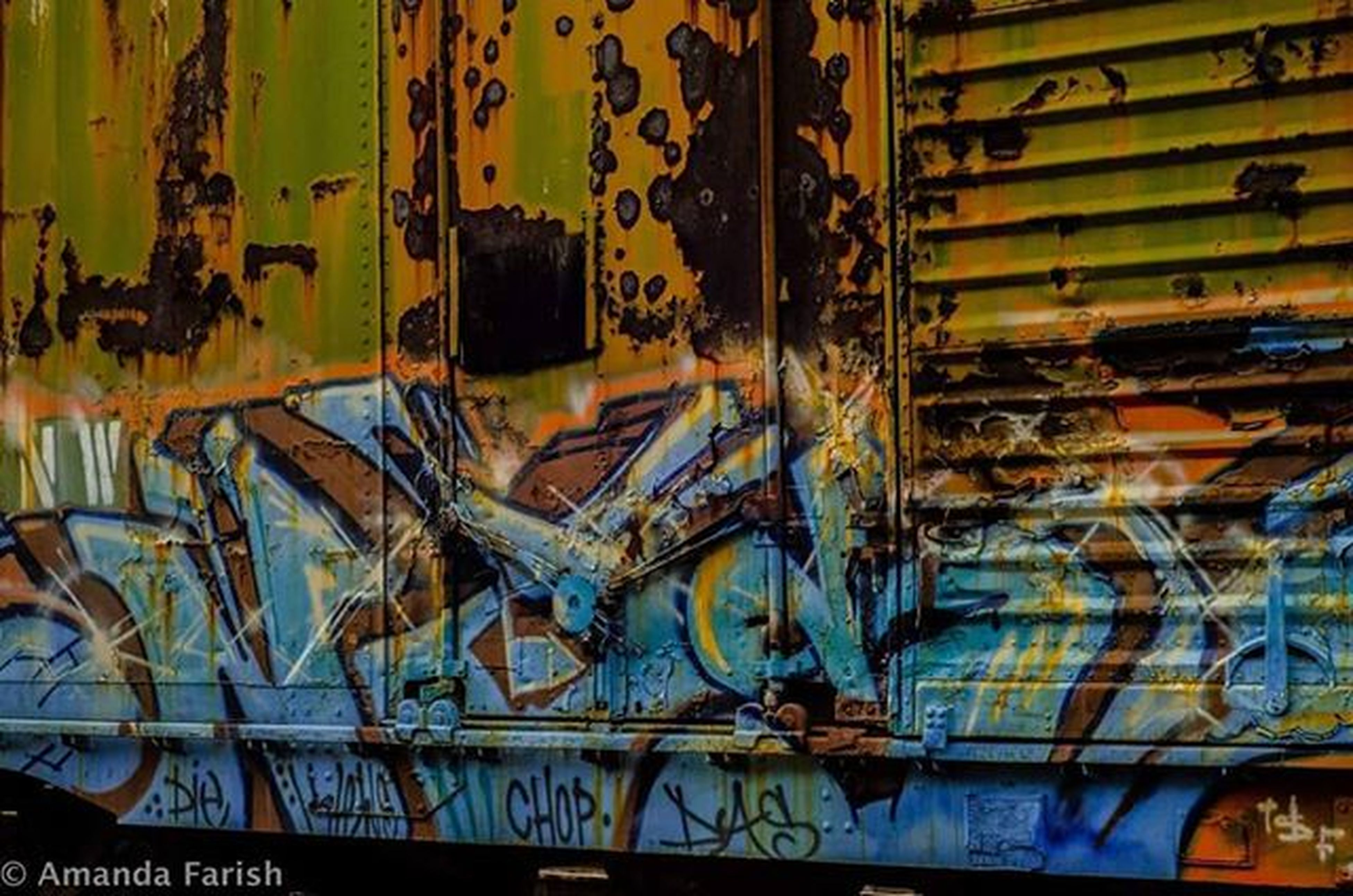 indoors, graffiti, art, art and craft, wall - building feature, creativity, metal, no people, ceiling, interior, full frame, backgrounds, in a row, abandoned, built structure, close-up, messy, glass - material, illuminated, pattern