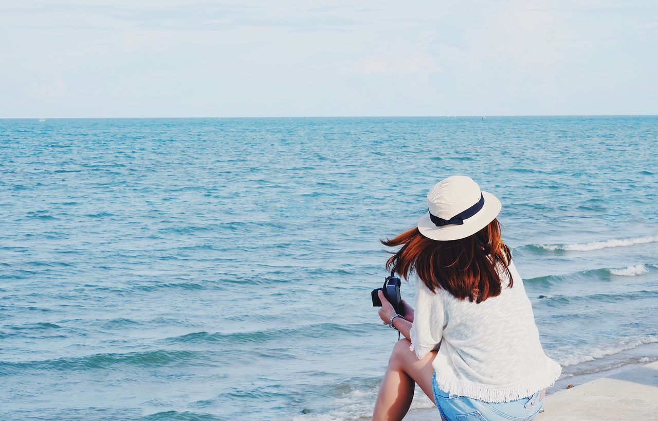Live For The Story Sea Horizon Over Water Rear View One Person Women Scenics Nature Beauty In Nature Leisure Activity Beach Water Real People Outdoors Sun Hat Vacations Sky Young Adult Day One Woman Only Camera Photographer Seascape Summer Summertime
