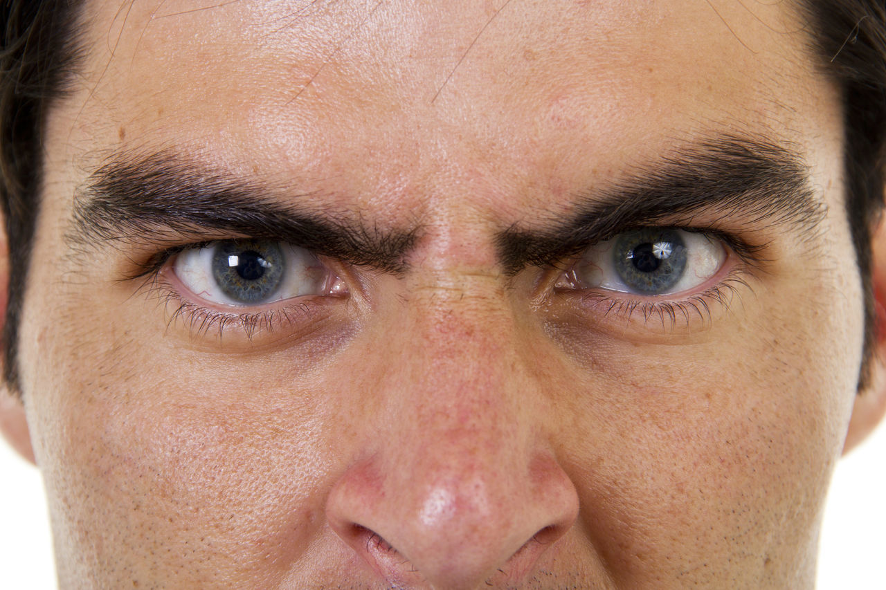 Closeup of angry male face Adult Adults Only Anger Angry Blue Eyes Caucasian Close-up Expression Expressive Horizontal Human Face Looking At Camera Male Man One Man Only One Person Only Men People