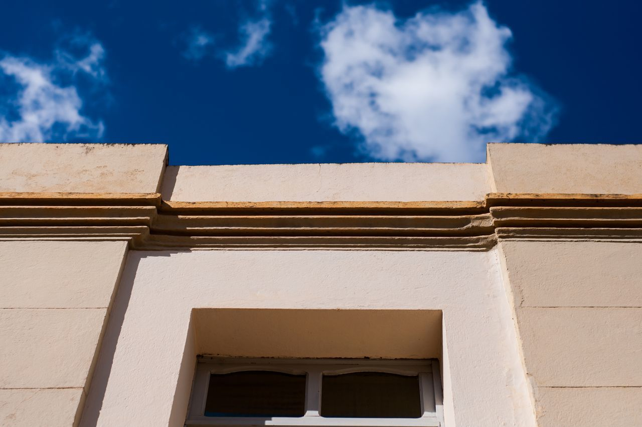 low angle view, architecture, built structure, building exterior, cloud - sky, sky, day, outdoors, no people, sunlight, whitewashed, blue