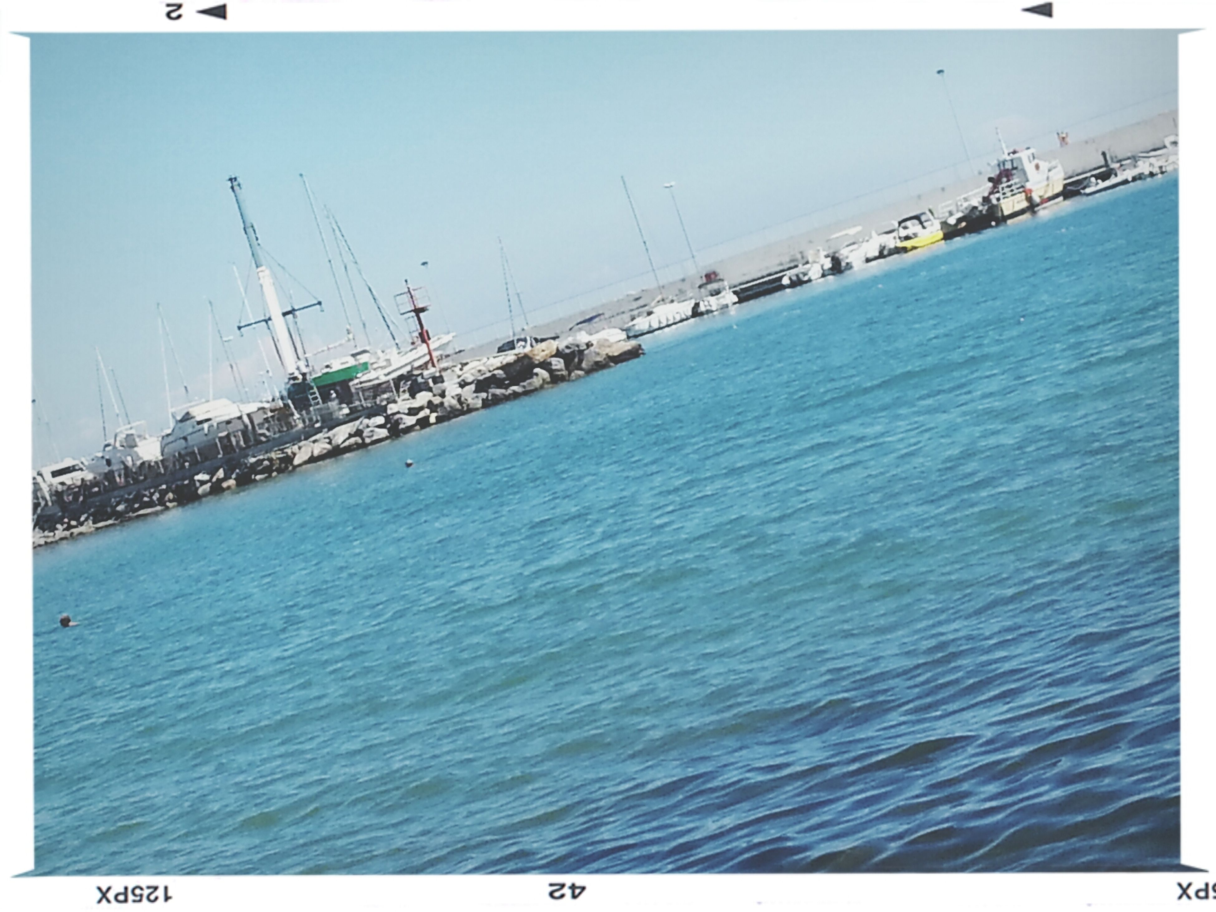 sea, water, nautical vessel, transfer print, blue, waterfront, transportation, horizon over water, sailboat, auto post production filter, boat, mode of transport, clear sky, nature, tranquility, tranquil scene, rippled, sky, mast, harbor