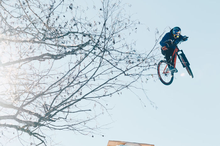 Let the good times roll! Or fly... Adventure Low Angle View One Man Only One Person Extreme Sports Outdoors Headwear Sky Stunt Slopestyle MTB