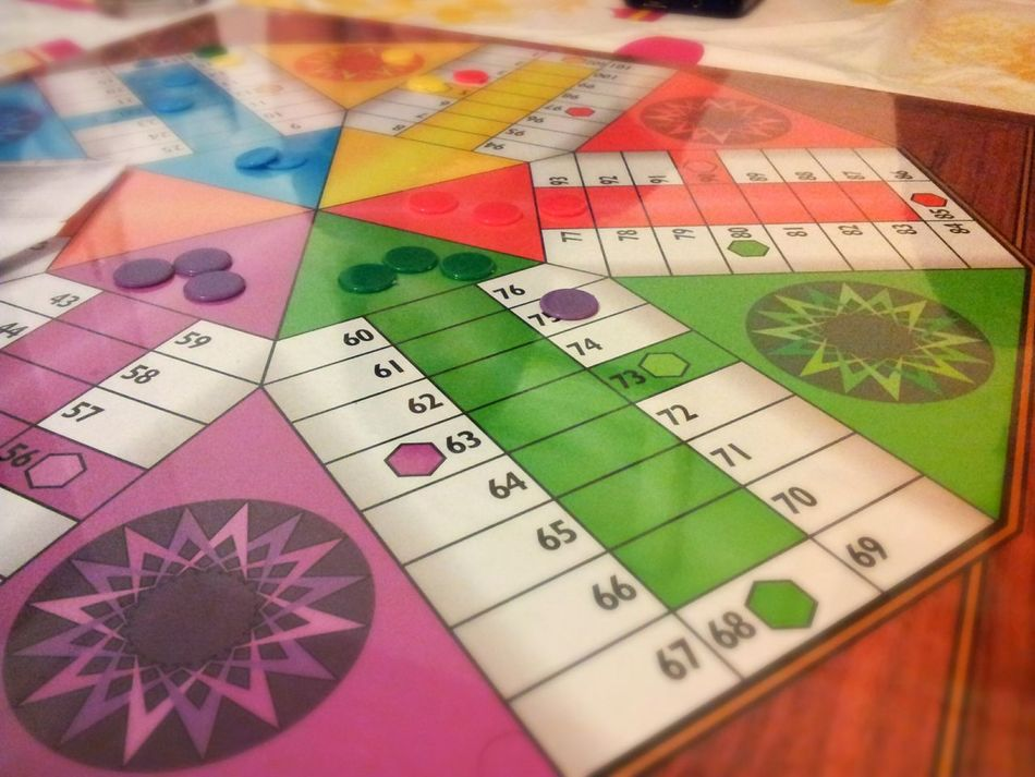 Playing Parchis Boardgames