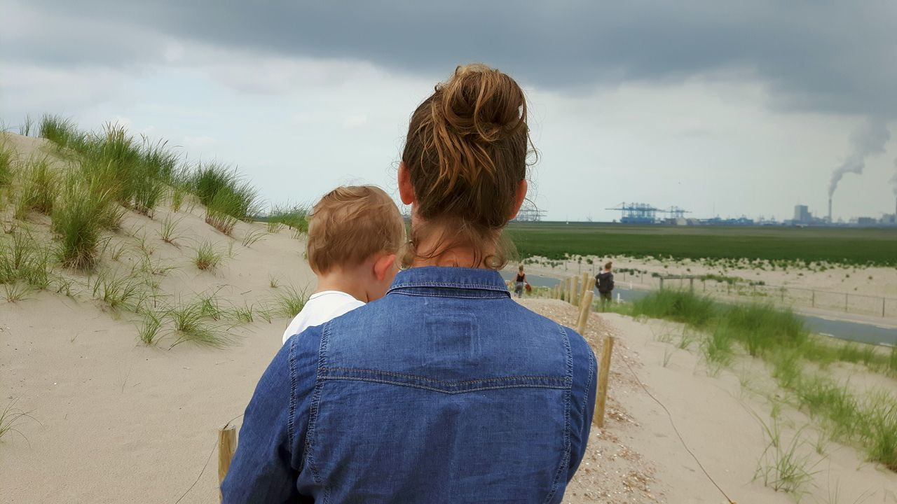 Rear View Women Togetherness Beach Two People Mother And Child Motherhood Motherslove Childhood Children Photography EyeEmNewHere Tweede Maasvlakte Noordzeestrand Noordzee Children Of The World Serious Toddlerlife Toddler Photography Toddlersofeyem Toddler Boy Child Child Photography Childphotography Childhoodunplugged Walking The Portraitist - 2017 EyeEm Awards The Street Photographer - 2017 EyeEm Awards Live For The Story Place Of Heart