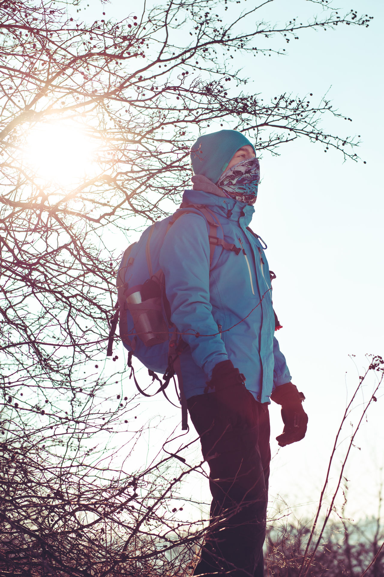Boy hiking through meadows in the wintertime Active Activity Alone Backpack Bandana Boy Cold Day Hike Hiker Journey Lifestyles Meadow Nature Outdoors People Person Snow Teenager Trip Vacations Vertical Winter Wintertime Young