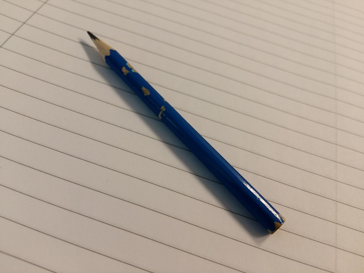 Blue Pencil on lined Paper Back To School Blue Pencil Close-up Day Day At School :) Day At The Office Education Indoors  Learning Lined Paper Lined Pattern No People Note Pad Office Day Office Supplies Paper Pen Pencil Pencil On Paper School Supplies Still Life Table Write Notes Down Writing Paper
