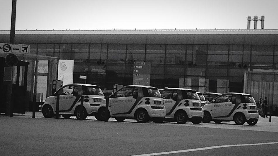 Bnw_friday_eyeemchallenge Urban Symmetry Blackandwhite Cars Smart Few Of The Same