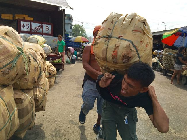 Porters transport goods at Carbon Market in Cebu City, central Philippines. Carbon Market is the oldest and largest public market in the city with over one hundred years of trading history. Cebu Philippines Porters Cargador Dockers Carbon Market, Cebu Showcase July
