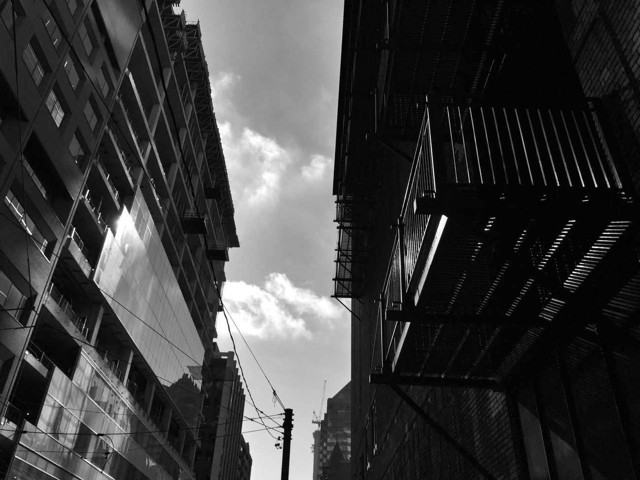 Going... Architecture Building Exterior Low Angle View City Cloud - Sky Built Structure EyeEm Best Shots EyeEm Gallery EyeEm Masterclass EyeEm Best Shots - Black + White Street Photography Darkness Light-Play Shootermag EE_Daily: Black And White Bw_collection Bw_lover B&w Street Photography Architectural Feature Building Story Black And White Blackandwhite Doinbuildings