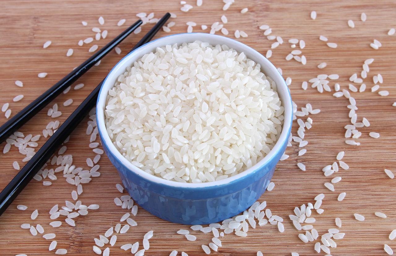 Uncooked rice in blue bowl ASIA Asian  Cooking Eating Food Meal Sidedish