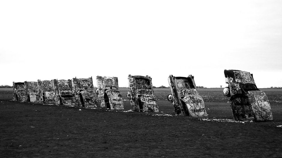 When they put me in the ground, I hope people will still come around. Large Group Of Objects No People EyeEmNewHere Cars Cadillac Automobile Landmark Cadillac Ranch Texas Graffiti Art Black And White Photography Noir Monochrome Landscape Bnwphotography Pattern Route 66