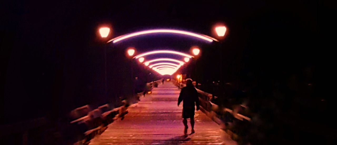Walking Illuminated Arched Rear View Full Length Lighting Equipment Night Tunnel Arch Dark The Way Forward Bridge Diminishing Perspective Narrow In A Row Pedestrian Walkway Pedestrian Footbridge Red Long Outdoors Waterfront Ocean Dark Lit