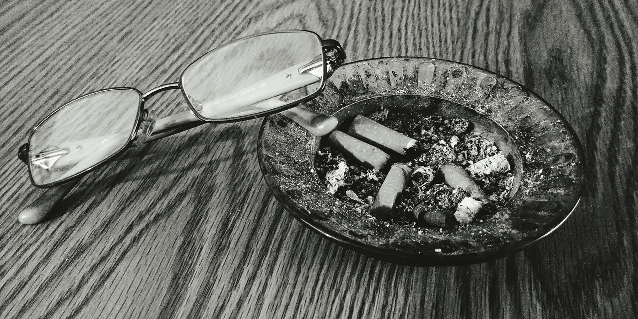 EyeEmNewHere High Angle View Indoors  Table No People Wood - Material Ashtray  Close-up Day Freshness