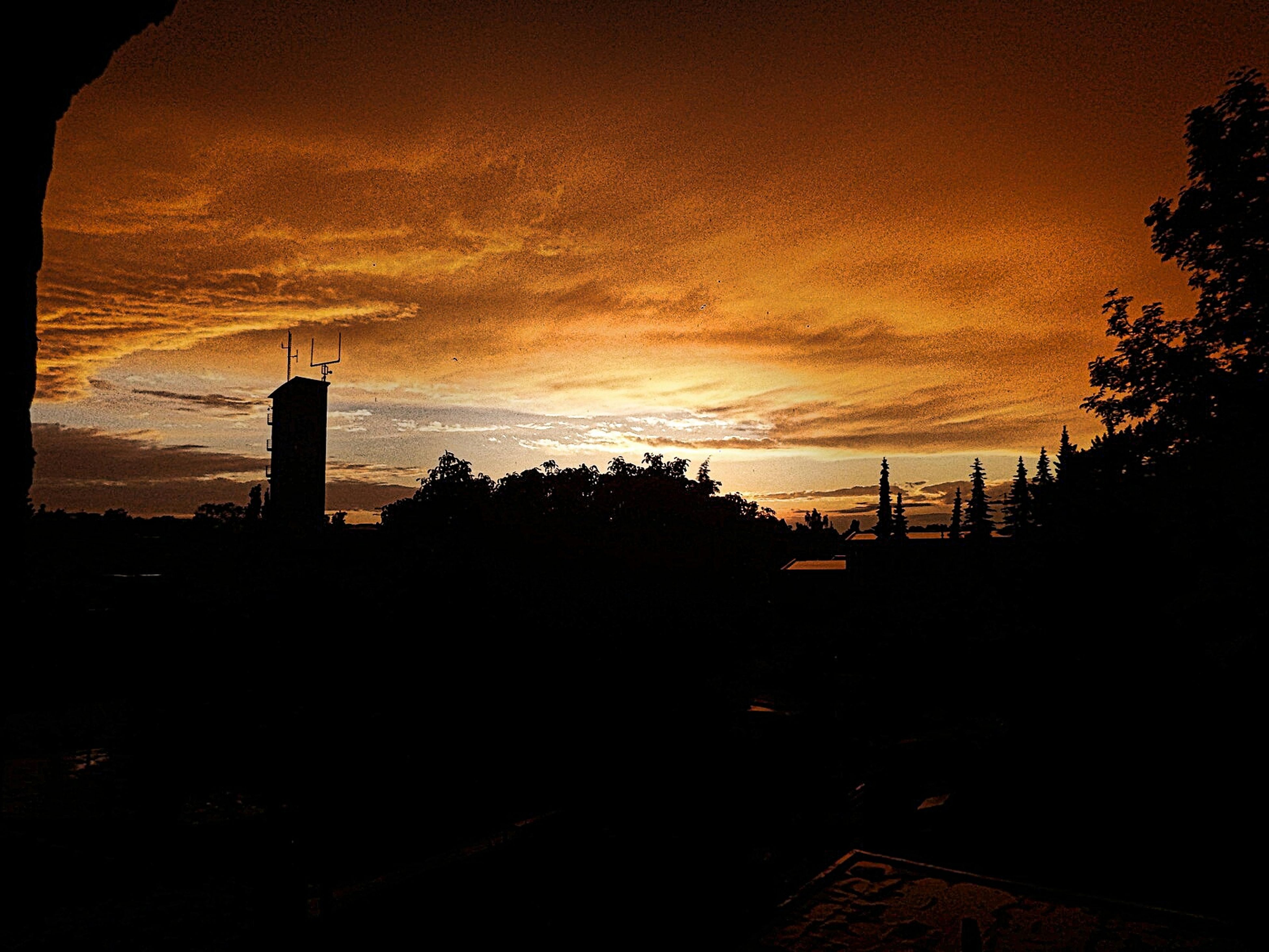sunset, silhouette, built structure, architecture, sky, building exterior, cloud - sky, tree, orange color, dark, dusk, dramatic sky, house, scenics, beauty in nature, nature, cloud, cloudy, outdoors, tranquility